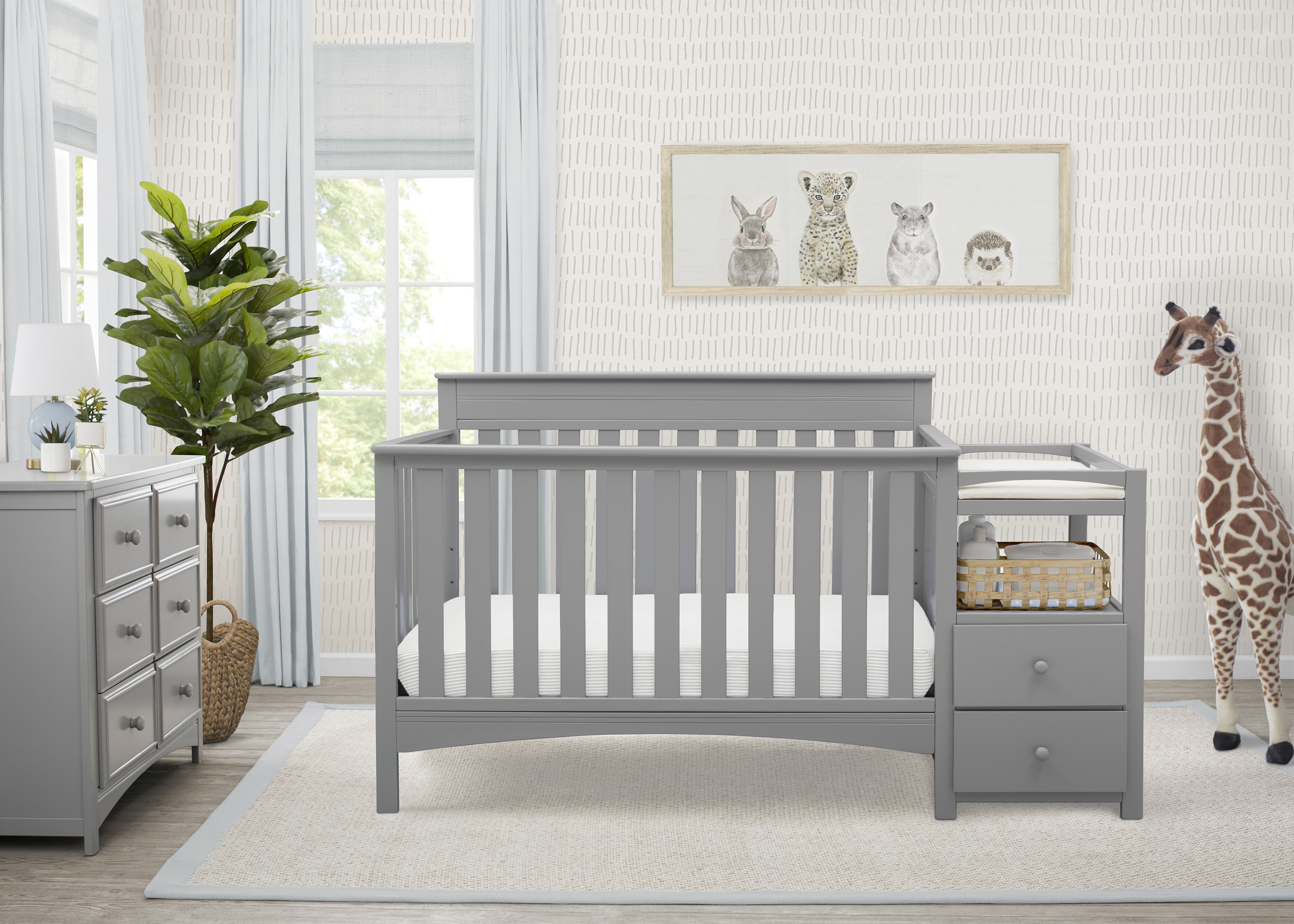 The grey crib and table, in a nursery