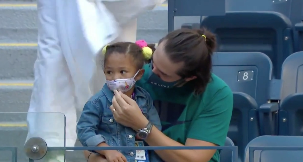 Alexis adjusting Olympia's mask.