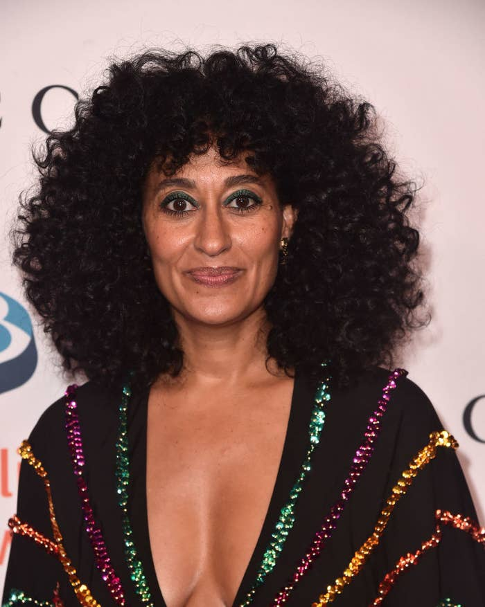 positive news Tracee Ellis Ross wearing dark makeup and a top with sequins