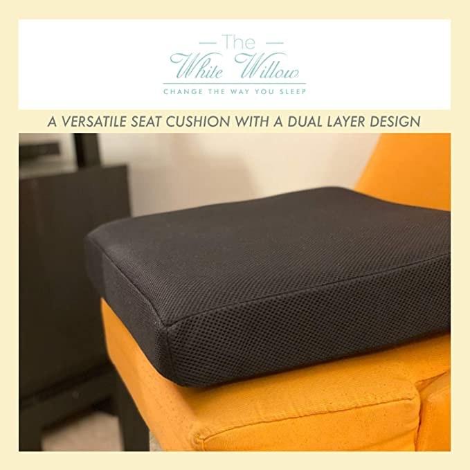 The Black memory foam cushion on an orange chair