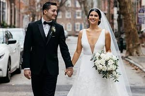 A groom holding hands with a bride