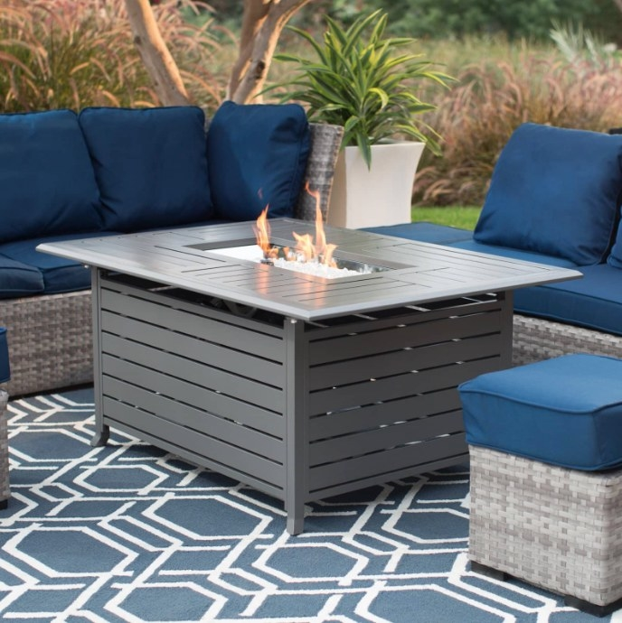 The grey outdoor fire table