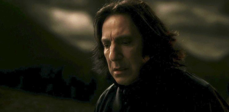 Snape looking down at Harry after Harry tried using Sectumsempra on him.