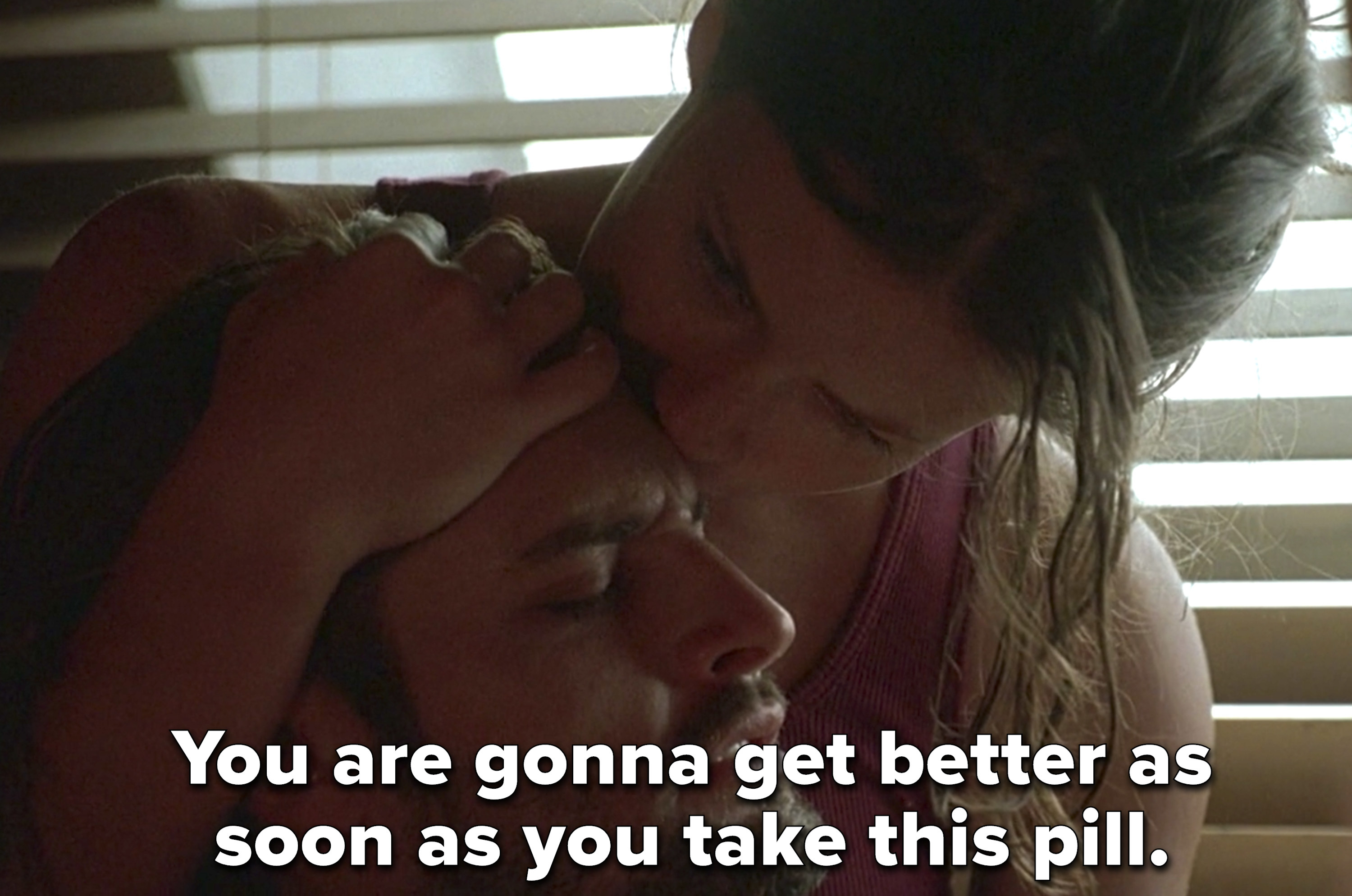 Kate kisses Sawyer's forehead and says he'll get better if he takes the pill