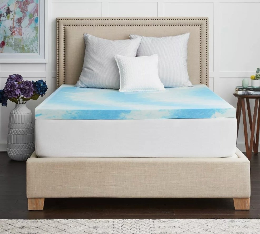 The blue and white cloud-shaped mattress pad