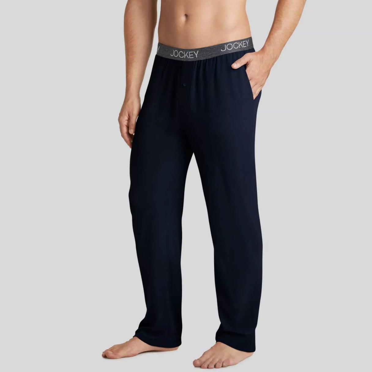 model wearing black pajama bottoms