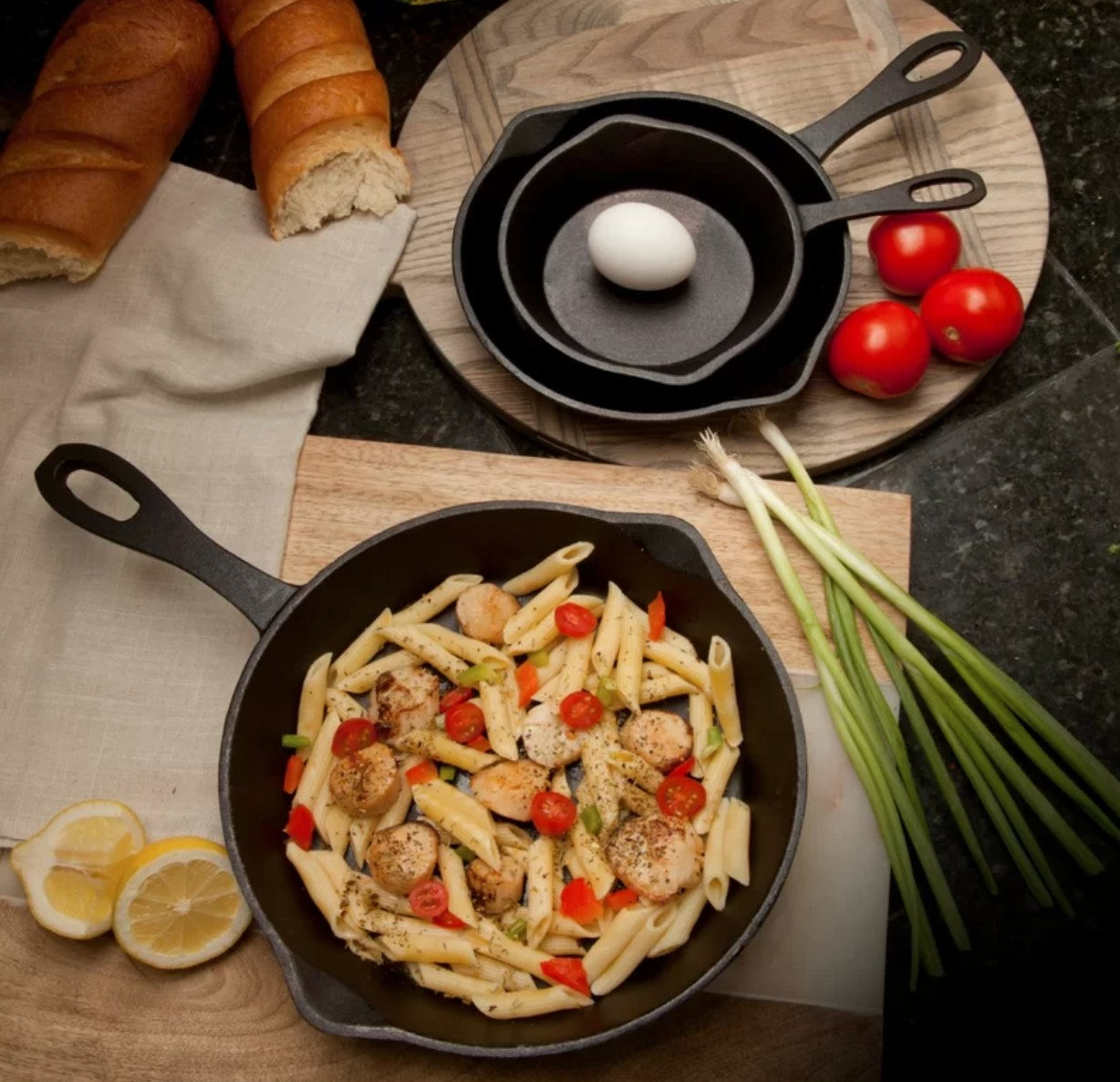 The three skillets being used for a pasta dish