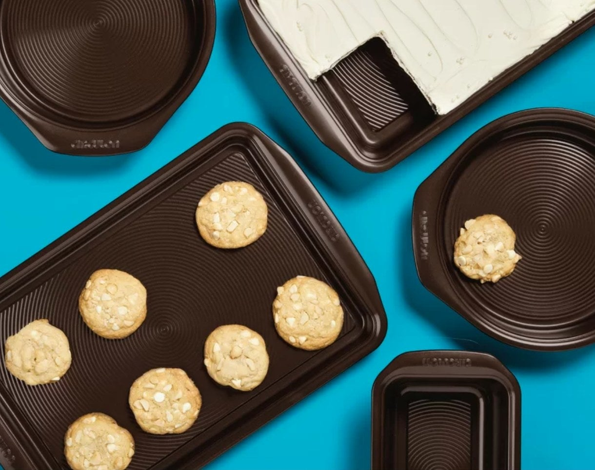 The chocolate-colored bakeware set being used to make cookies