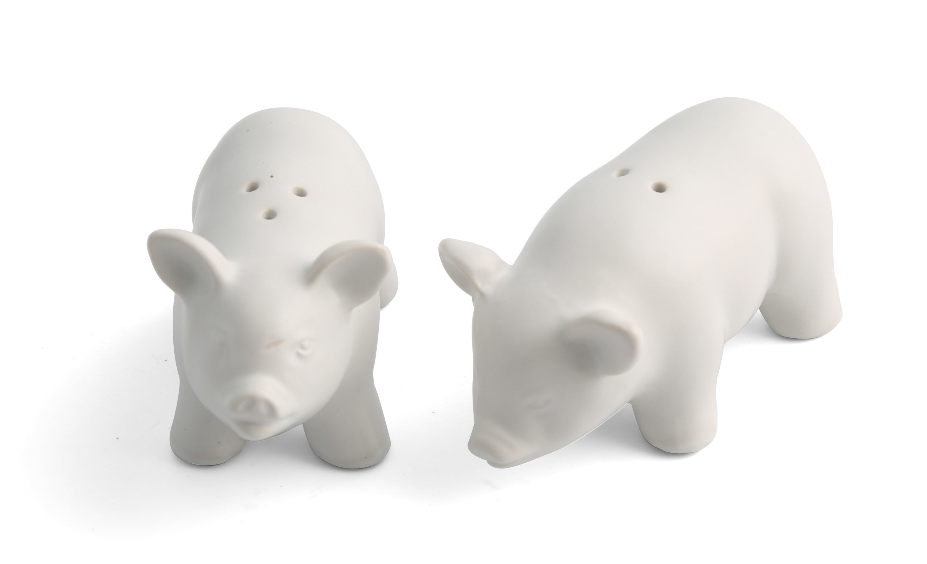 White ceramic pig-shaped salt and pepper shakers