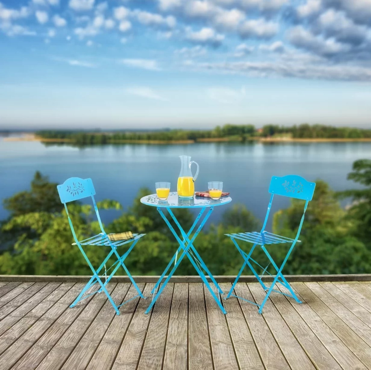 The blue bistro chair set on a deck