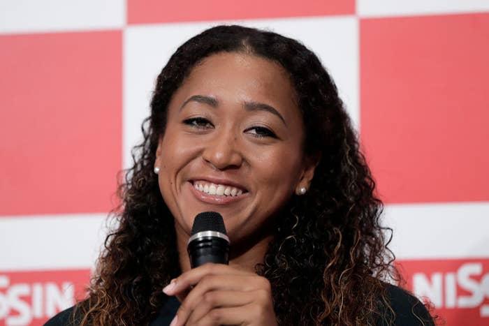 Naomi smiling