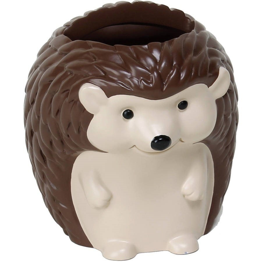 A resin toothbrush holder in the shape of a hedgehog