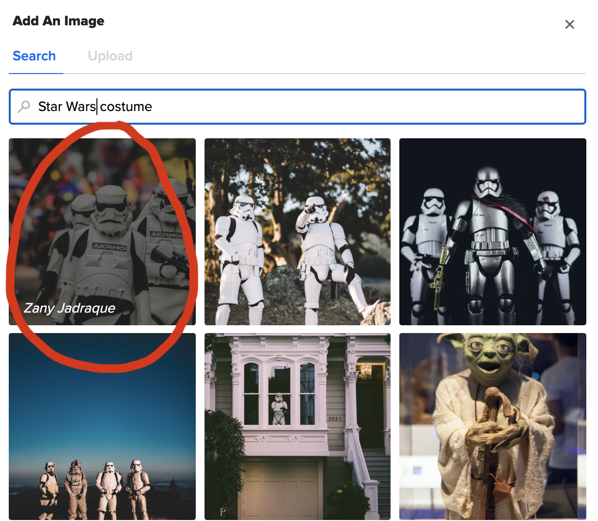 "A screenshot of the image uploader on the BuzzFeed quiz maker. A search bar has the words ""star wars costume"" typed into it and six star wars images are below it, with one circled in red"