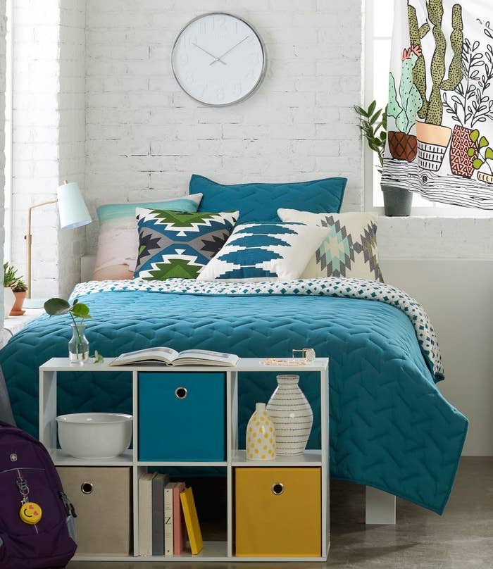 White shelf by end of bed