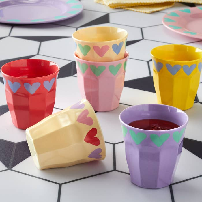 A heart shape adorned cups in various colors