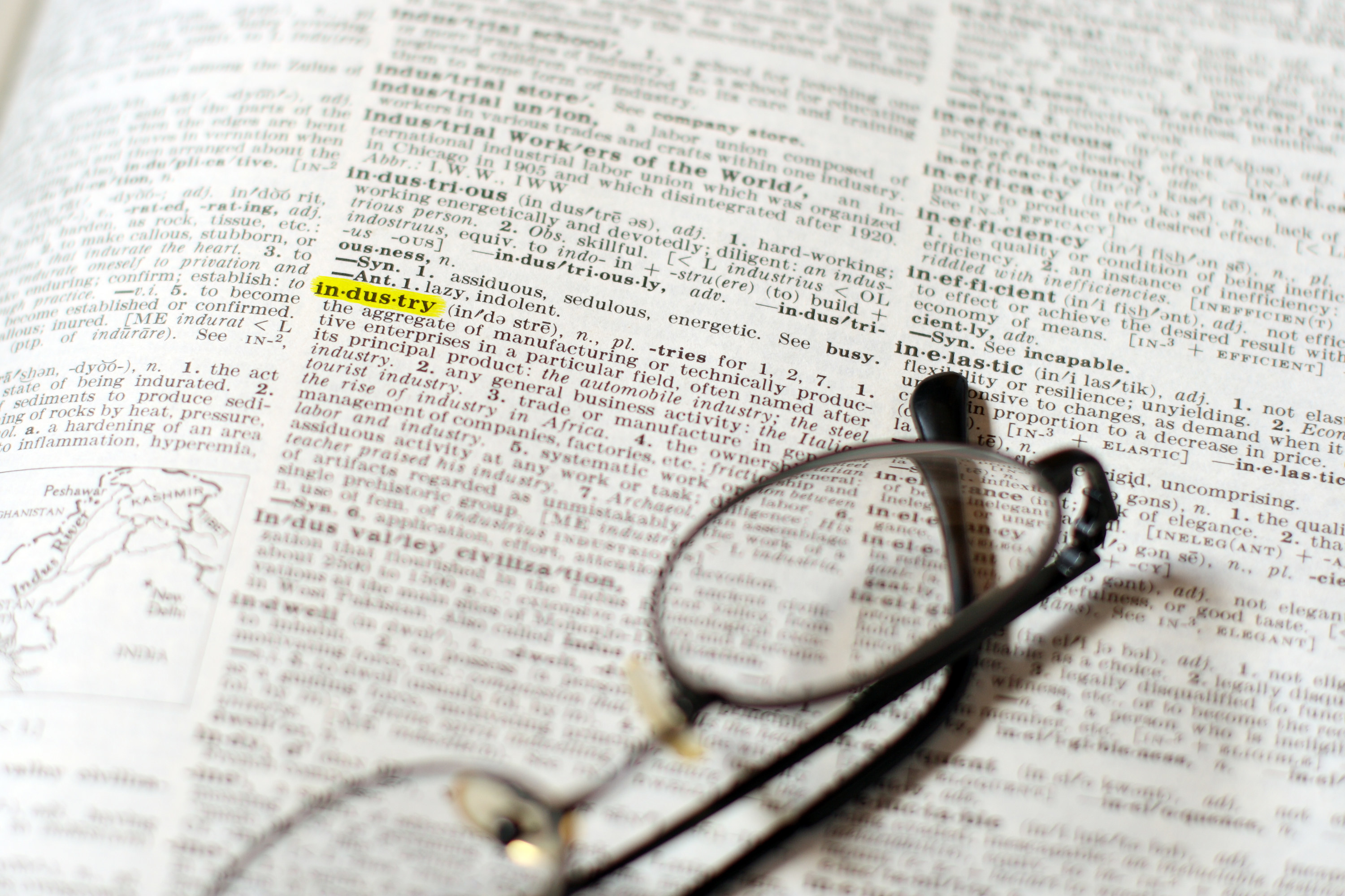 Glasses on an open dictionary