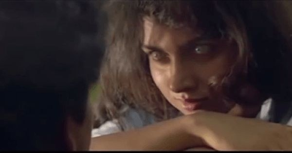 A possessed Revathi stares at her costar in the movie raat