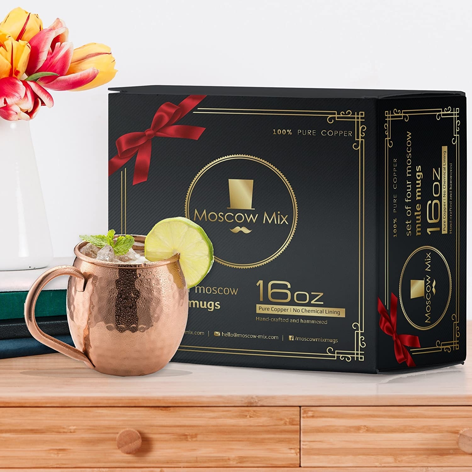 A Moscow mule cup on a table with the box that it comes in