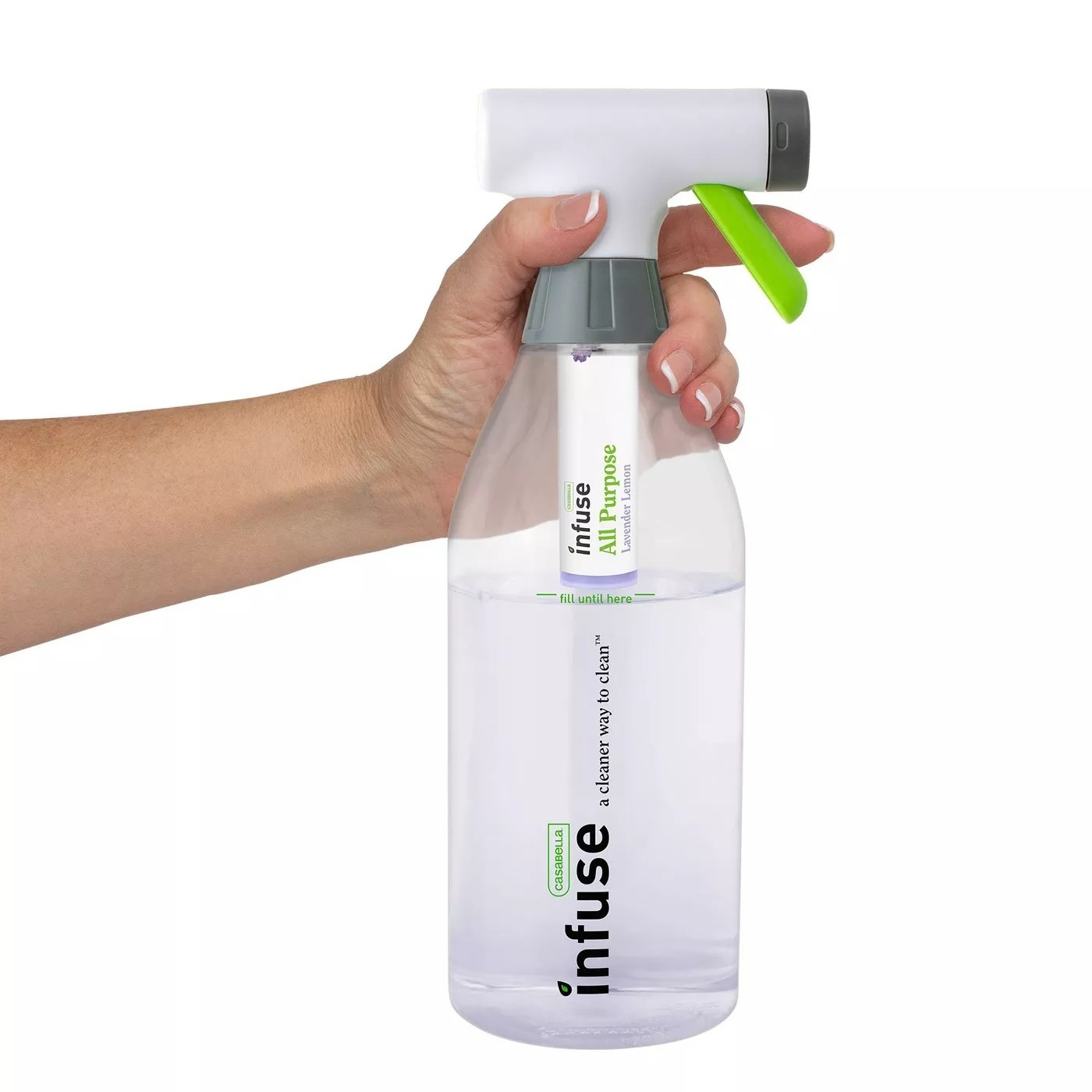 """""""A model holding the trigger on a refillable bottle of Infuse's lavender-scented, all-purpose cleaning spray"""