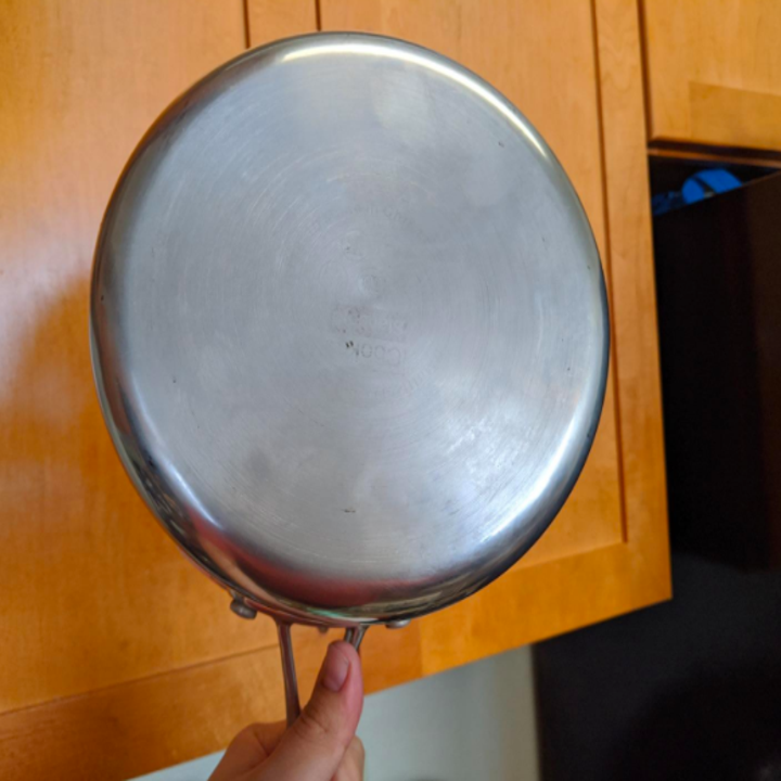 The pan restored to spotless, shiny silver