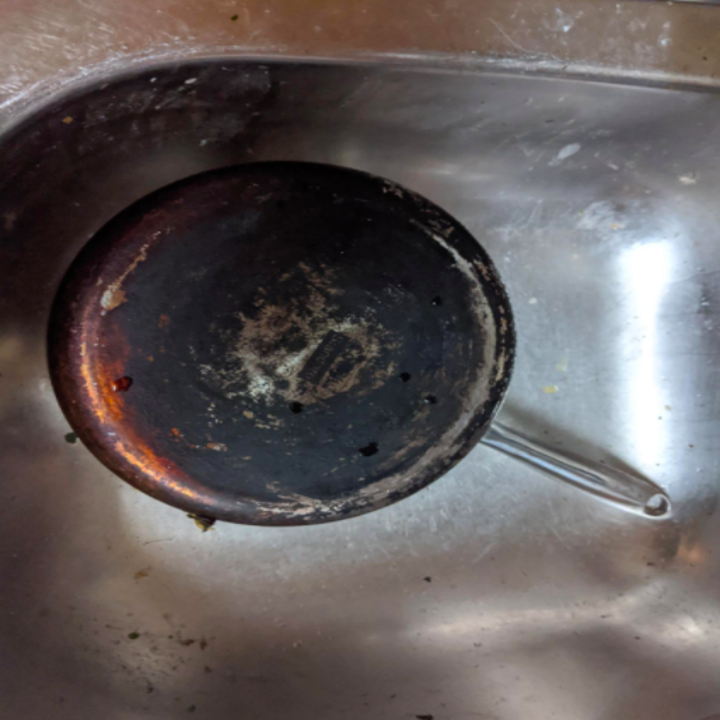 A reviewer's pan black with caked on grease