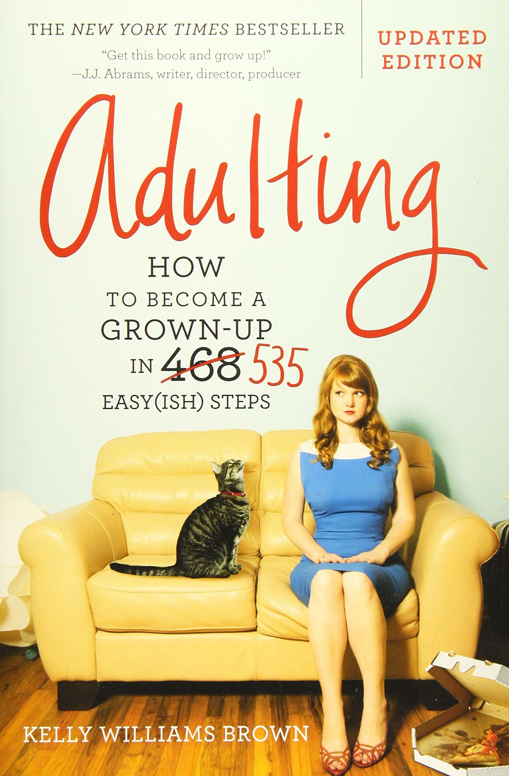 the cover of the book which shows a young woman and her cat sitting on a couch