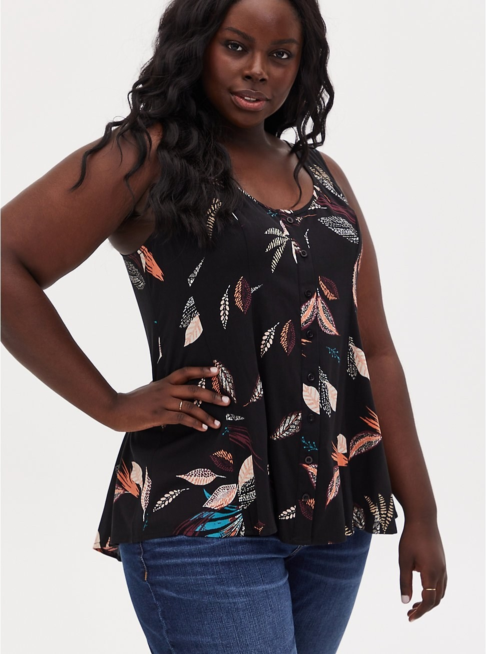 Black flowy tank with multi-colored leaf pattern and buttons down front