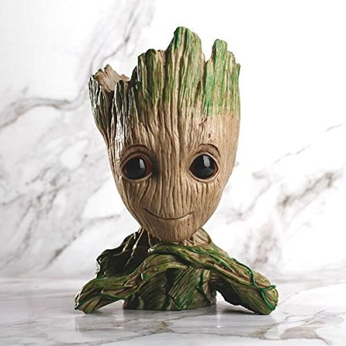 A Groot pot with its hands folded below its chin.