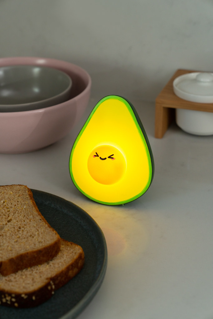 An animated glowing avocado