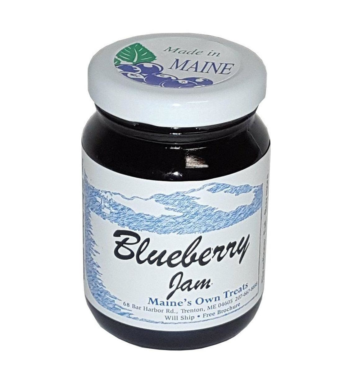 A jar of Maine blueberry jam in a pretty jar with a blue and white label.