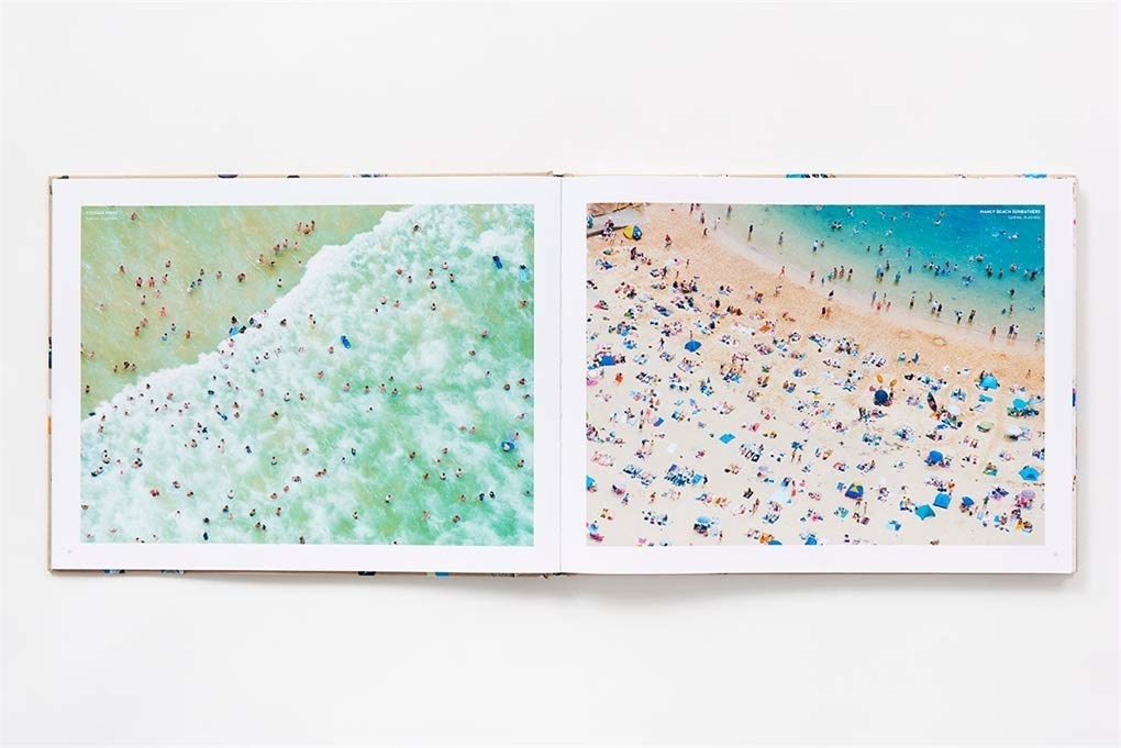 "A full-bleed of Gray Malin's ""Beaches"" book displaying two bright and cheery beach photos."