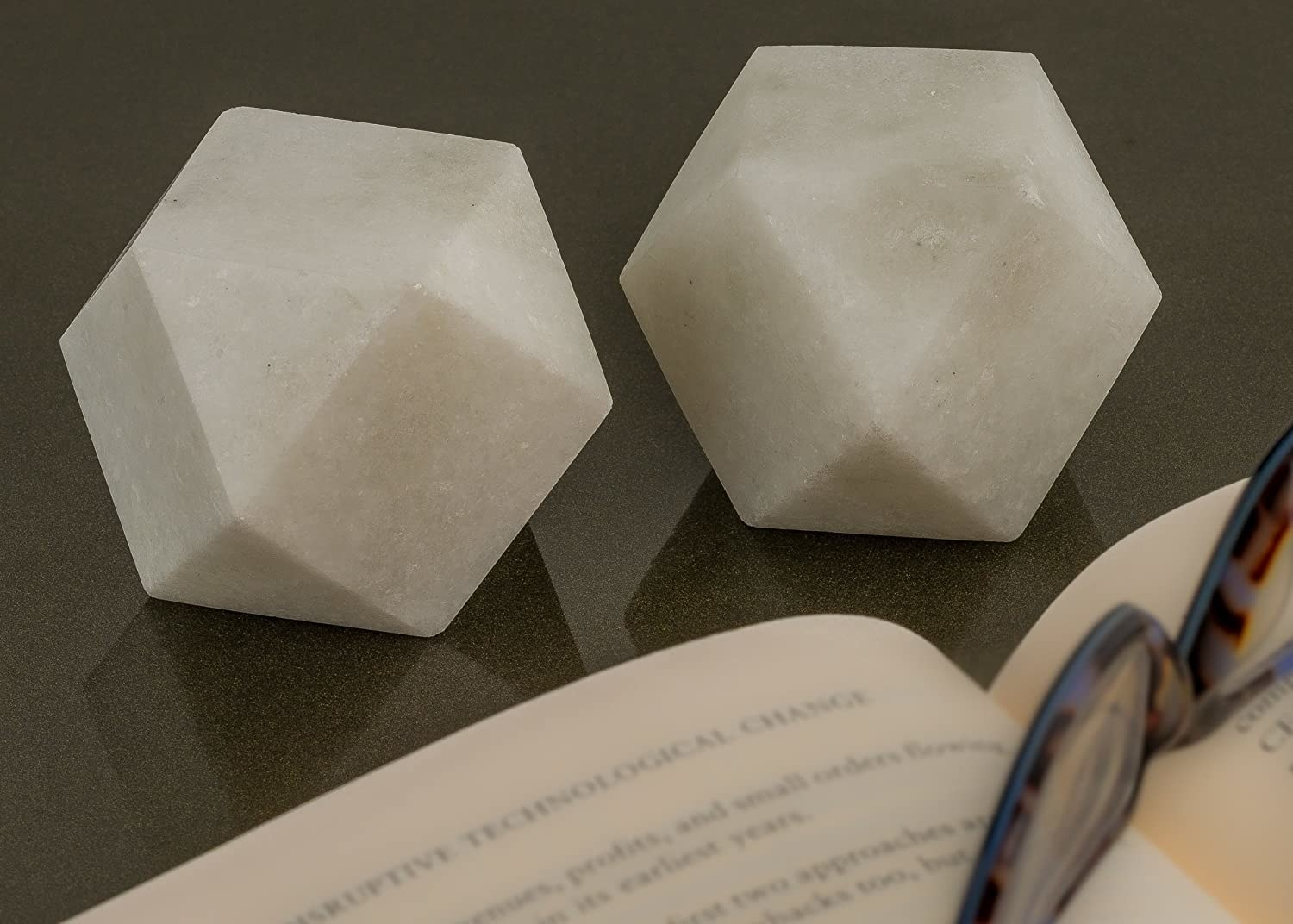 2 marble paperweights in a geometric design.