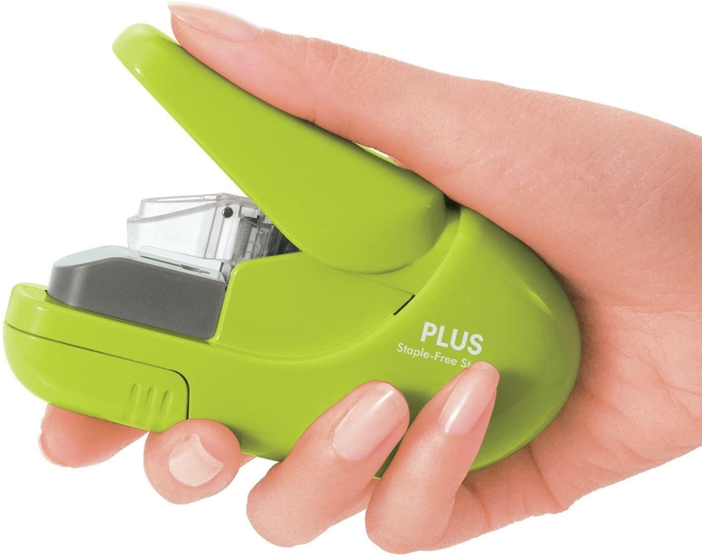 Model's hand holding a lime green stapler