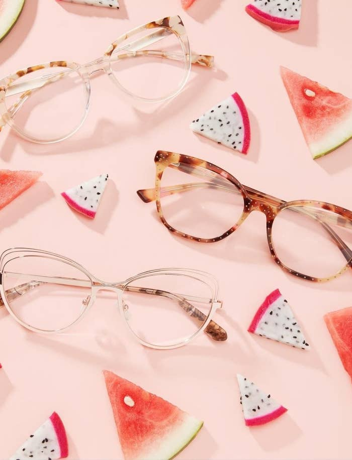 three pairs of frames near watermelon and dragonfruit