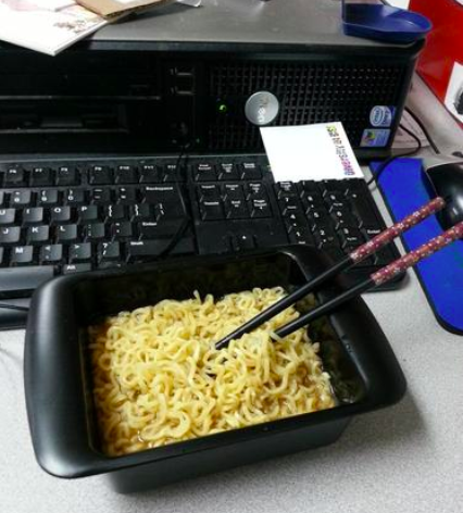 A reviewer's cooked noodles in the maker, which is black and rectangular and can also be used as a bowl