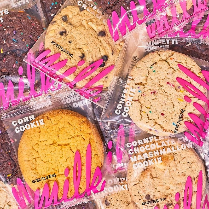 A pile of wrapped cookies from Milk Bar in flavors like marshmallow, corn cookie, and confetti cookie.