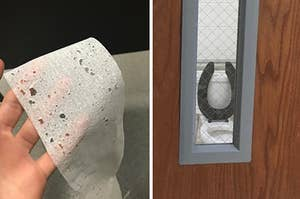 A sheet of toilet paper riddled with holes and a bathroom door with a window on it