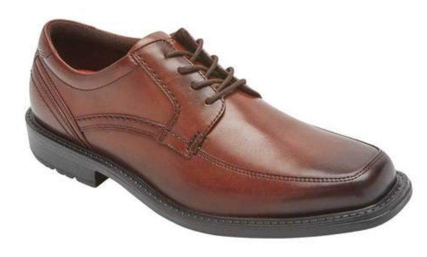 Brown dress shoe with brown laces and black sole