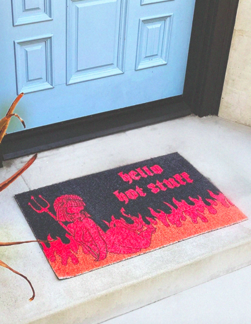"Red, orange, and black door mat that says ""Hello Hot Stuff"" with Valfré Lucy artwork"