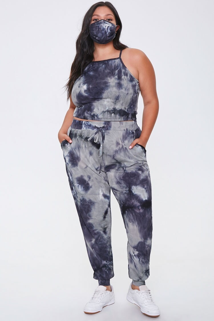 Model wearing blue tie dye joggers, matching crop, and matching face mask