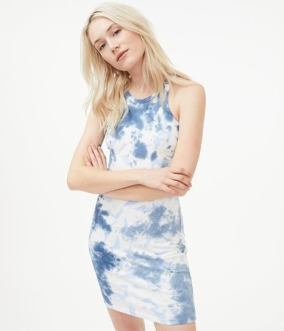 Model in the blue and white tie-dye dress