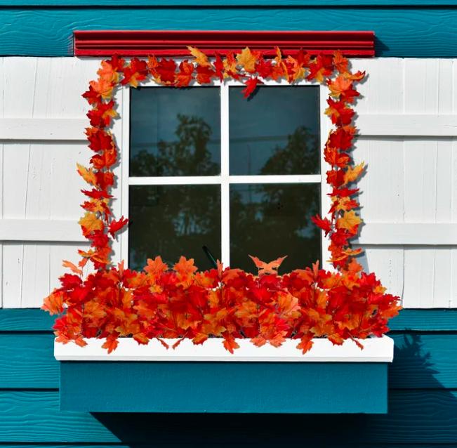 Red leaf garland around a white window