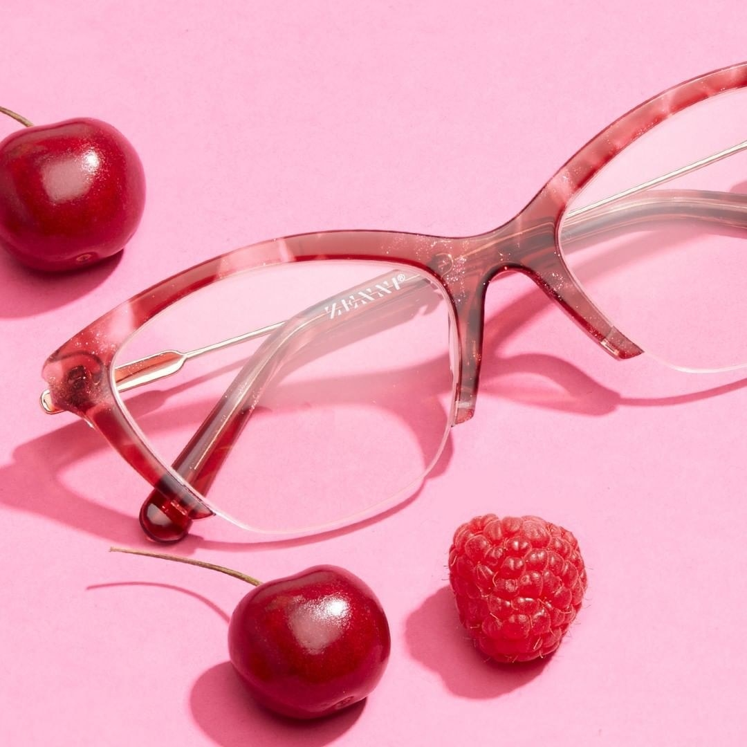 The pink, half-framed tortoiseshell glasses