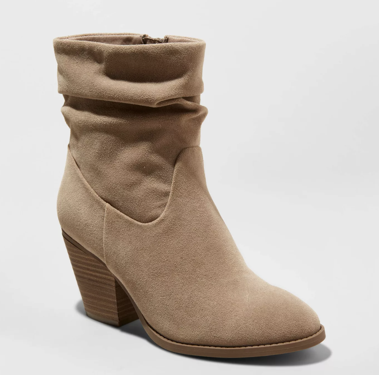 taupe colored slouchy boots with a stacked wooden heel