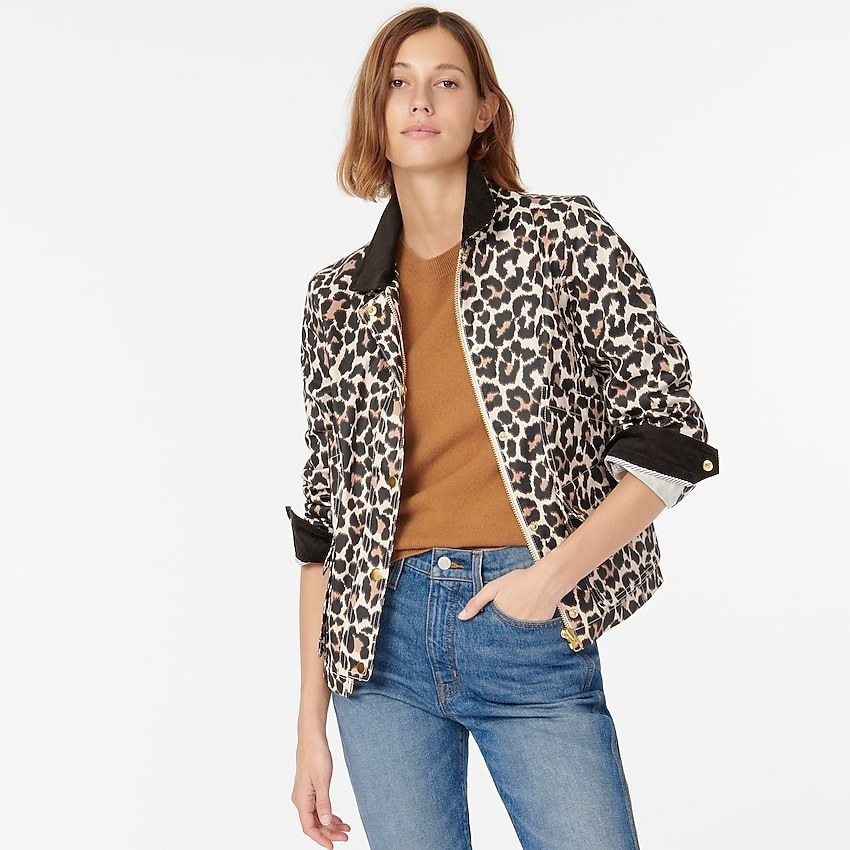 Model wearing the barn jacket with a brown leopard print, contrasting brown collar and cuffs, and zip-front.