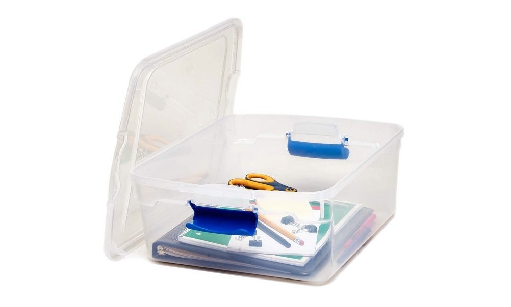 The clear storage packet holding folders, pencils, and scissors