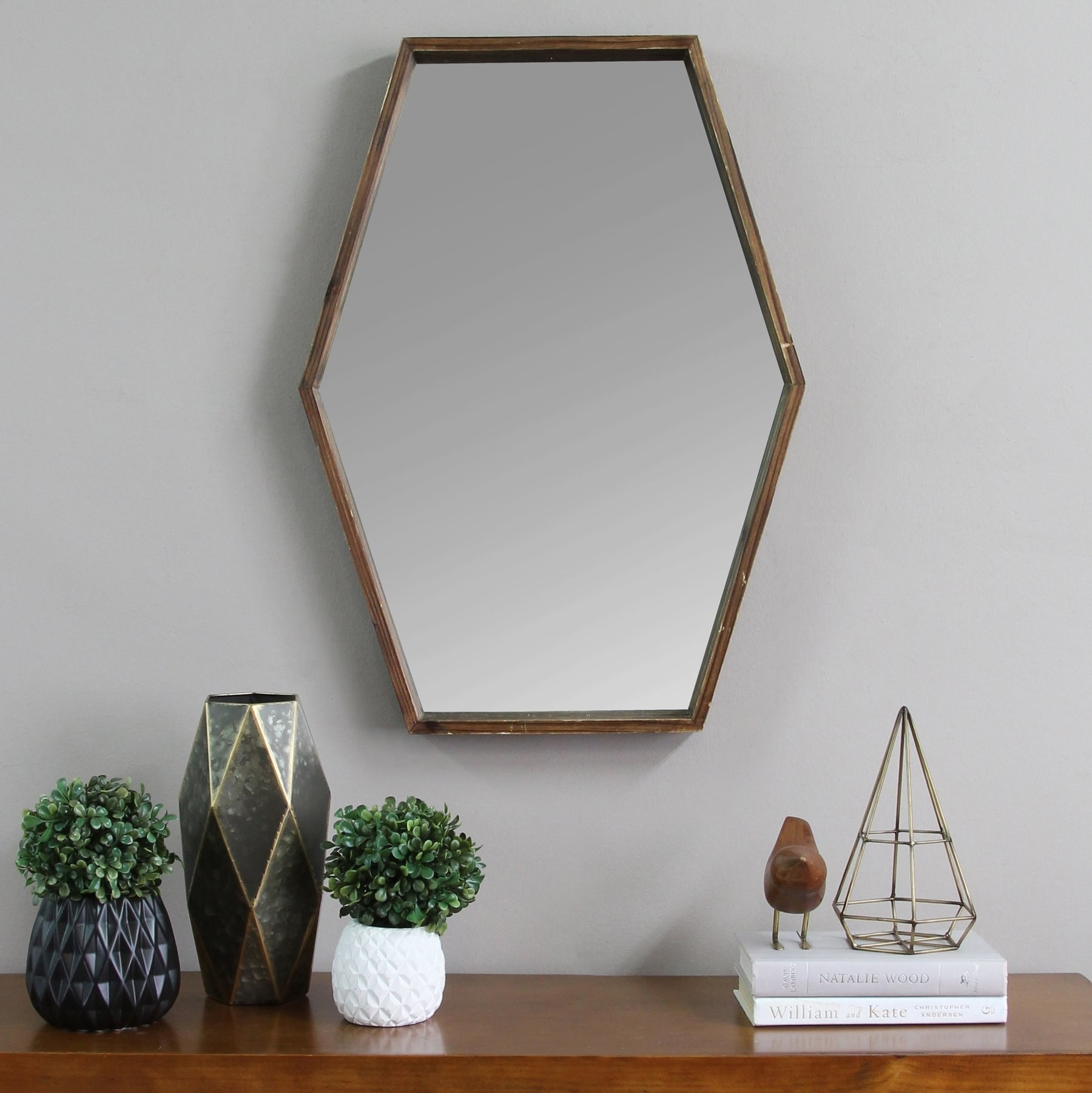 The wooden-framed mirror