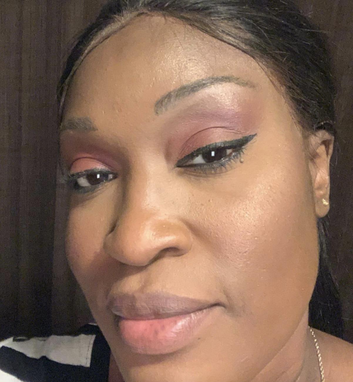 reviewer wearing black eyeliner