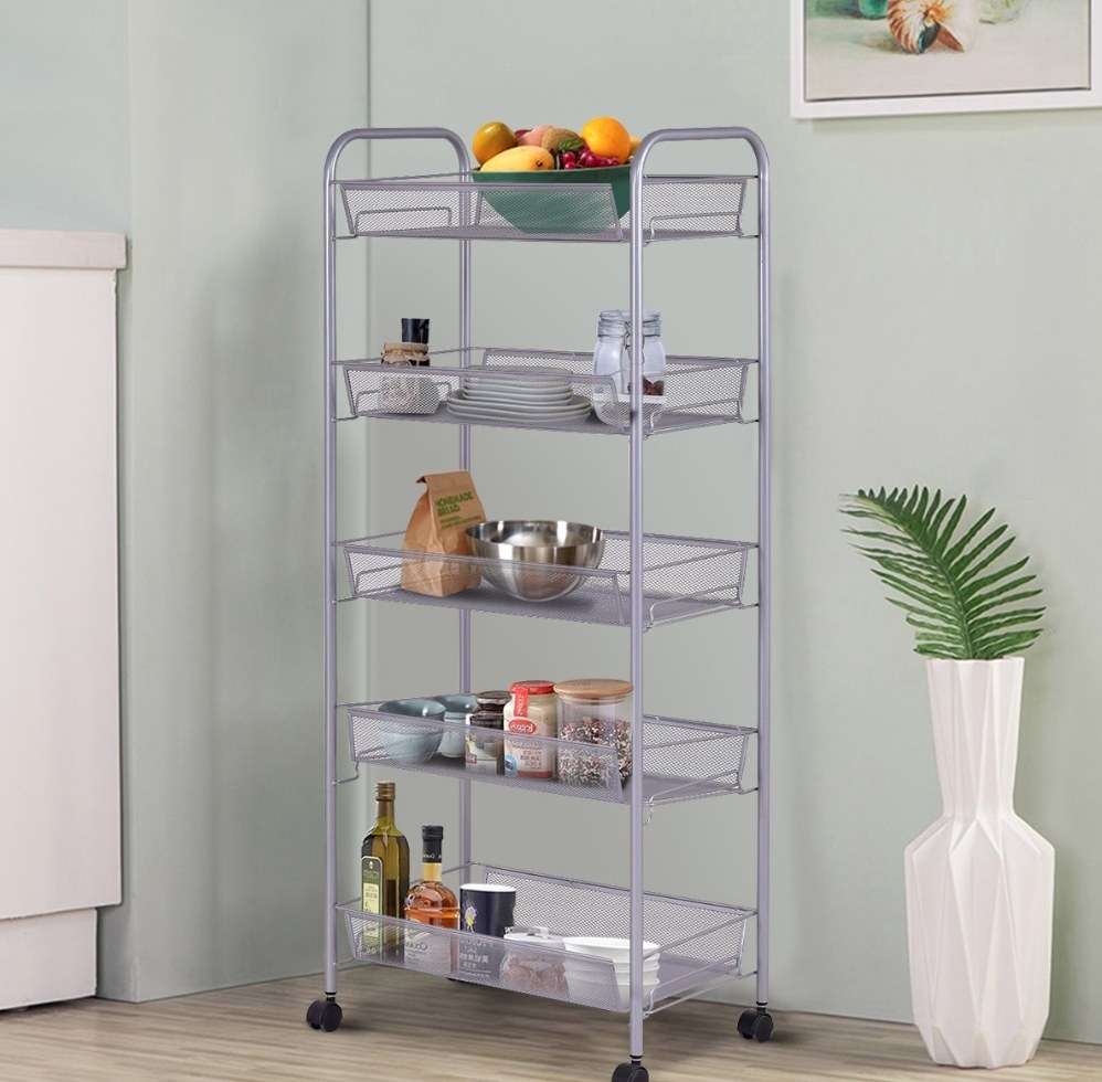 A steel cart with wheels that holds various kitchen products