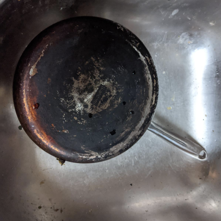 Bottom of reviewer's pan, covered in black tarnish